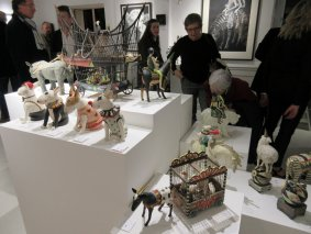 Preview guests enjoying a ceramic sculpture display